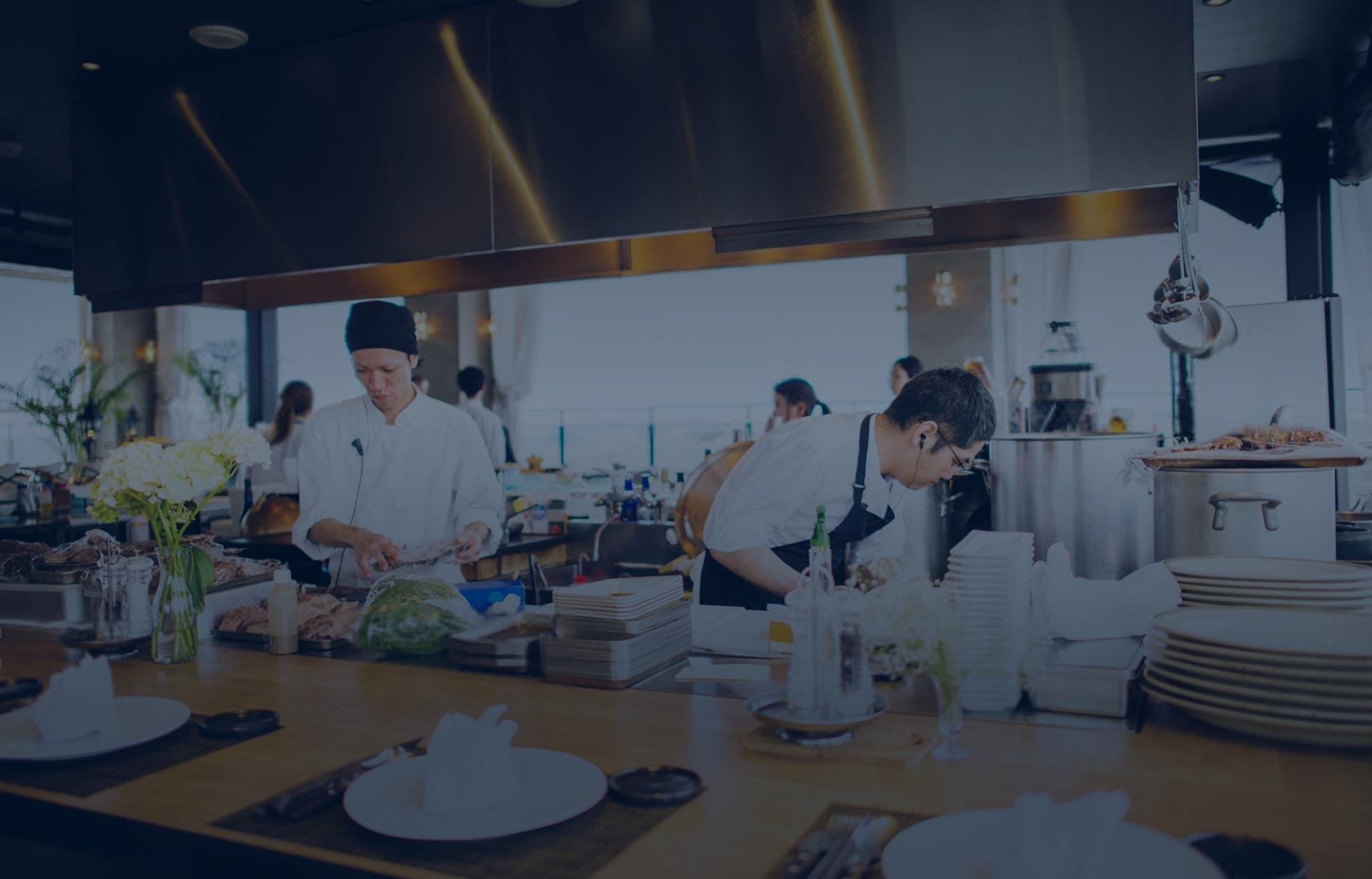 Chefs and cooks working in a clean, open kitchen