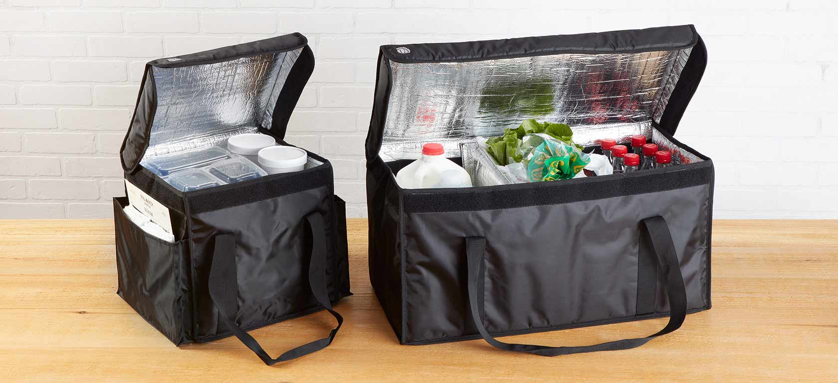 Black insulated carryout holders with shoulder straps.