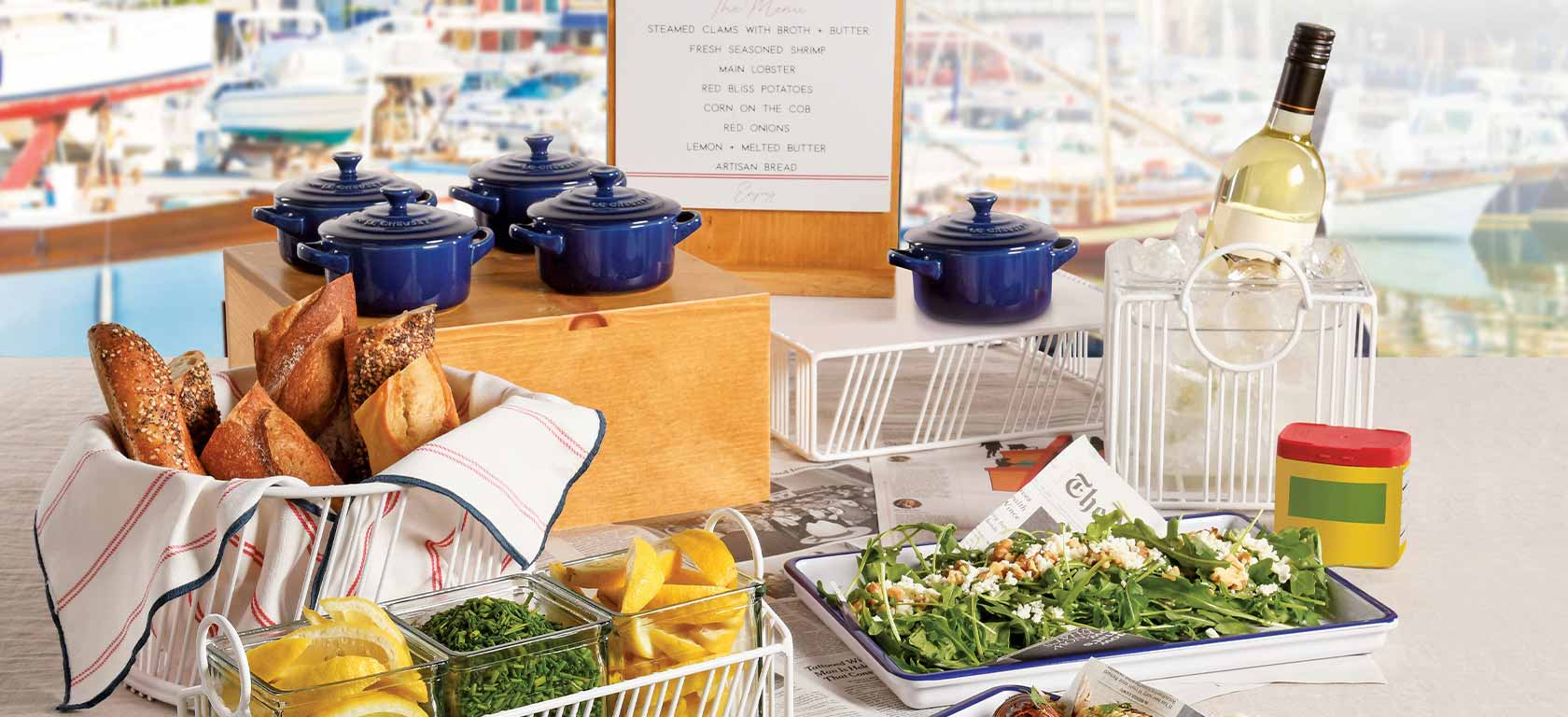 Array of blue ceramic pots rurrounded by fresh ingredients and a garden salad.