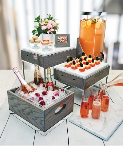 Assorment of fresh beverages on gray modern ice holders.