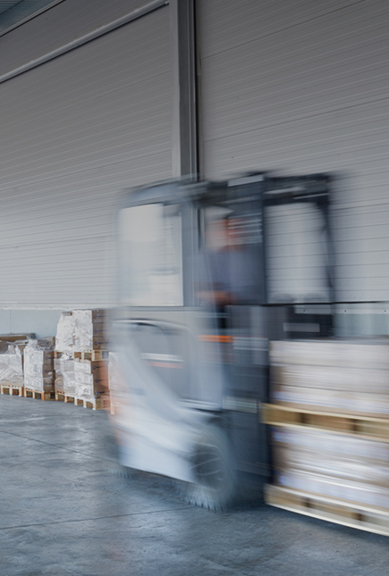 Forklift carrying pallet blurring at a high speed