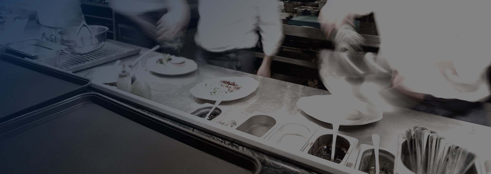 Line cooks prepping food in fast pace kitchen with blue gradient overlay