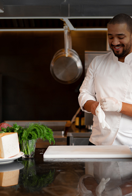 Bearded chef preps food in an open kitchen.